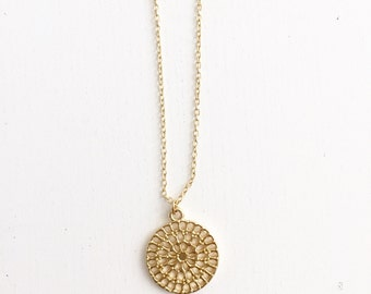 Thin necklace with round patterned pendant, gold plated, pendant necklace