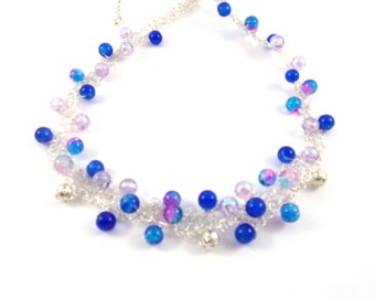 Silvery  necklace with blue , silvery , blue-pink pearls , silvery wire .