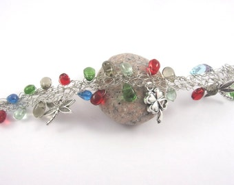 Silvery bracelet with multicolored pearls and silvery charms , wire .