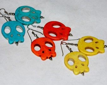 Silver earrings with skulls