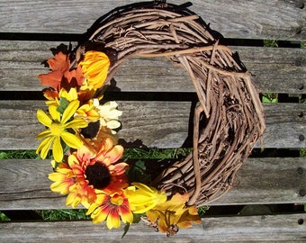 Fall Wreath.  Grapevine Wreath, 12 inch, with silk flowers in fall colors, Sunflowers, Cone Flowers.  Door wreath, wall decor. Thanksgiving.
