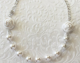 Pearl, silk, and silver necklace