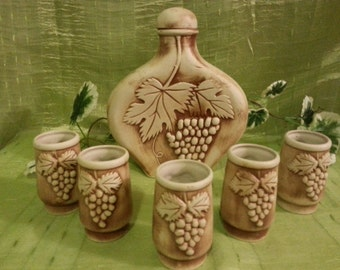A set of ceramics for wine: the decanter and five glasses