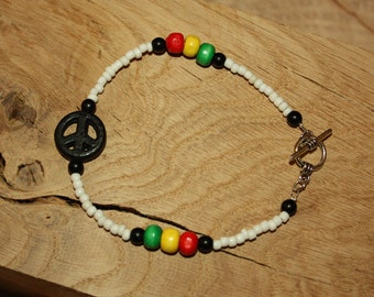 Beaded White Rasta Bracelet with coloured wood beads and howlite peace sign.