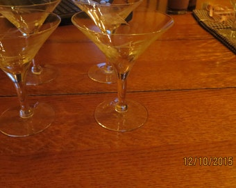Goblets four etched goblets or wine glasses with grapes and stem