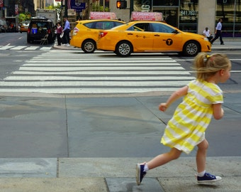 Racing the Taxi, NYC photo, New York photography, street photography, taxicab, playful child