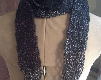 Crochet skinny scarf with fringe in black mixed with white and brown