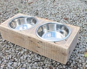 Wooden dog feeder stand made from reclaimed pallet timber - includes two stainless steel bowls. Wooden pet feeder station.