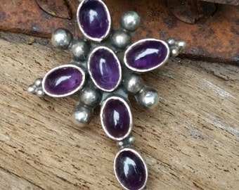 Beautiful amethyst and sterling silver cross pendant. Retired design.