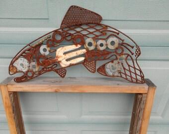 Rusty recycled metal salmon garden art