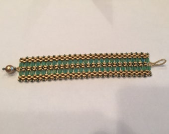 green and matte gold beaded bracelet