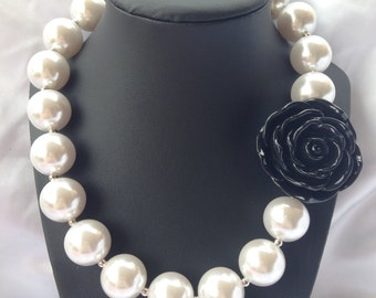 Girls bubble gum pearl necklace with black flower