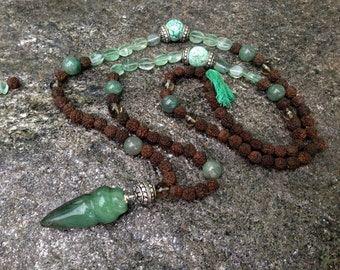 Mala of Rudraksha with natural stones ( turquoise, nephritis, smoky quartz , fluorite )