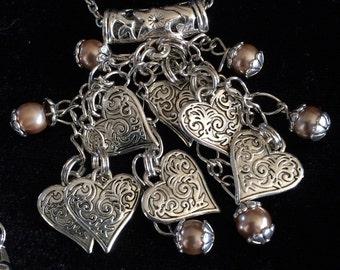 CalliopesCollections silver tone hearts and swarovski pearl necklace.