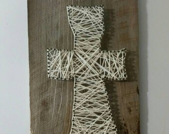 Beautiful handmade cross nail string art on 70 year old reclaimed Barnwood