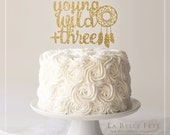 YOUNG, WILD + THREE gold glitter cake topper with dreamcatcher
