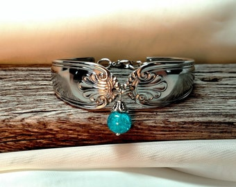 Spoon Bracelet scroll design with  blue crystal drop