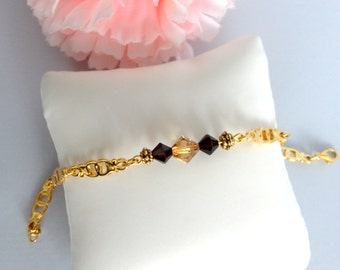 Bracelet purple and yellow tops transparent with gold chain