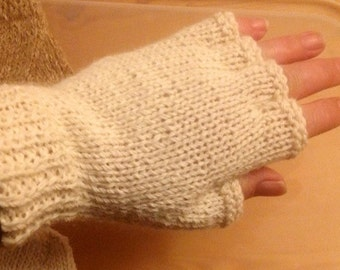 One pair of fingerless mittens hand knitted in 100% alpaca yarn. Choice of two colours white or brown