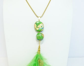 Pendant with green feathers and polymer clay beads