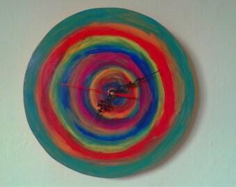 Wood wall clock with circular patterns