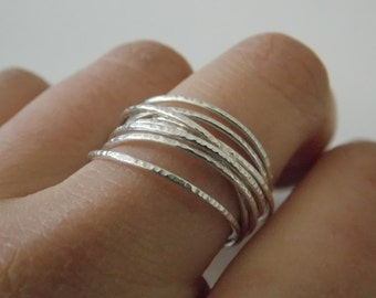 Silver fine and modern hammered ring with 8 interlace rings. The ring is delicate and pleasant to wear.