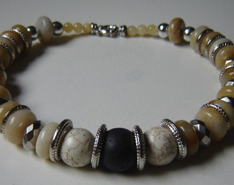 From chain chalcedony with lava and numerous metal pearls in antique finish - 50 cm long
