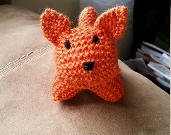 Knitted stuffed puppy