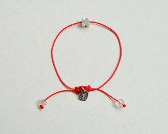 bracelet on red thread