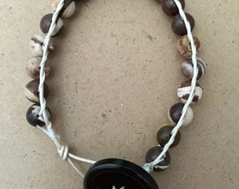 White leather and bead bracelet