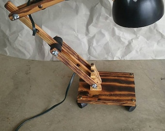 Desk lamp wood. Most is reclaimed wood from old barn. All new electronics used. Adjustable and made to look weathered.