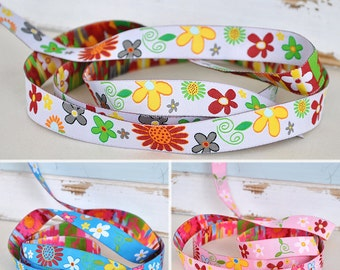 Web belts 16 mm wide with colourful flower motifs