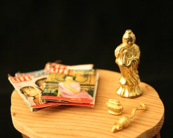 """Miniature End Table Décor- A Small """"Brass"""" Statue, a Table-top Cigarette Lighter, a """"Brass"""" Mouse, and 4 Issues of Life Magazine."""