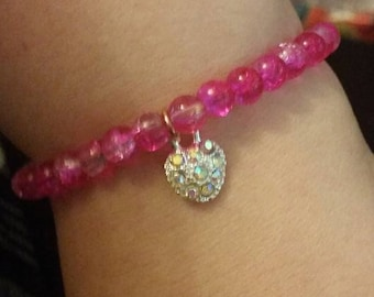 stunning pink bracelet with heart charm