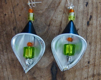 Green and black chandelier earrings made with recyclable materials