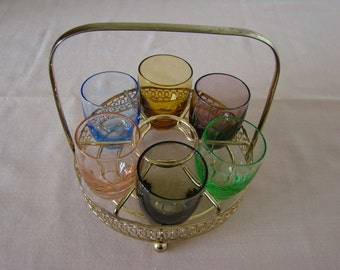 6 vintage harlequin shot/liqueur/sherry glasses with a gold metal carousel/holder/stand/rack/container/blue/black/green/amber/pink/purple,