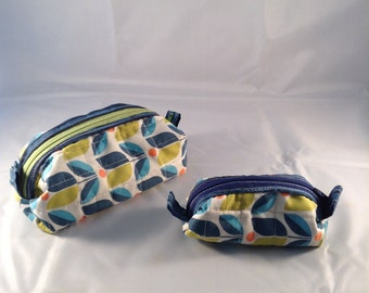 Two matching cosmetic bags, two small matching make-up bags, two small storage pouches