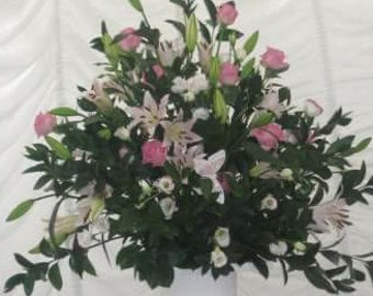 ChampersnBerries brings you beautiful Floral arrangements.   Made to order.