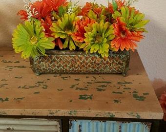Wicker base silk flower arrangement