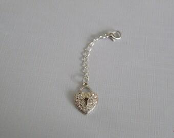 Small gem-encrusted heart charm