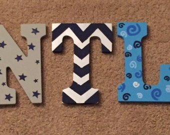 Hand painted, wooden nursery letters. Customized to enhance your nurseries theme and show off your babies name.