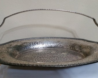 Silver Hammered platter with handle. Beautiful piece.