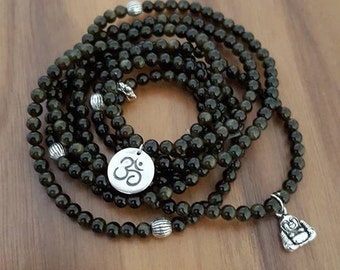 Bracelet style Buddhist obsidian black with reflections gold.  Silver charms 925.