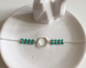 Elegant silver bracelet and chain spikes in turquoise