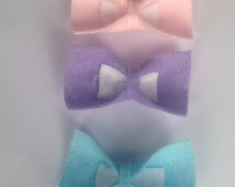 3 handmade pastel bows (blue,purple &pink)