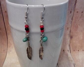 Silvertone feather dangle earrings
