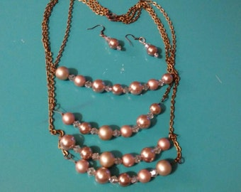 4-strand faux pearl necklace with matching earrings