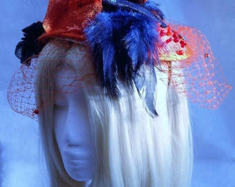Ladies bespoke Citrus Orange and Navy Blue saucer fascinator hat suitable for weddings, proms the races