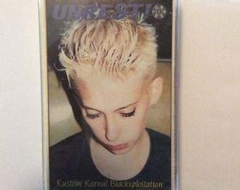 UNREST - Kustom Karnal Blackxsploitation cassette (Caroline)