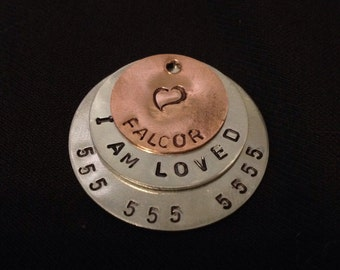 Hand stamped pet ID tag.